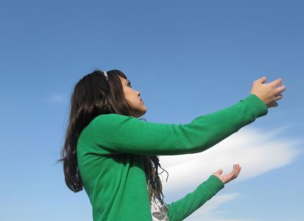 Girl reaching towards Heaven